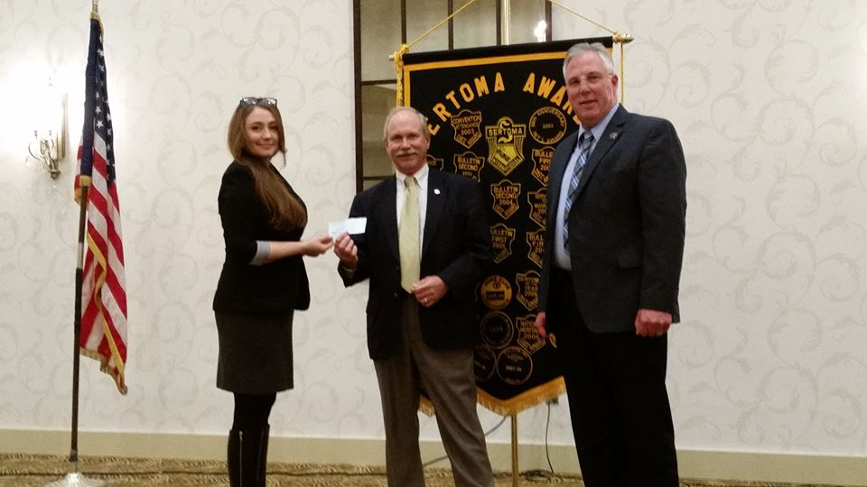 "Treasurer John Klinedinst, of the York Sertoma Club, presenting a donation to Jane Dietz and Sheriff Richard Keuerleber toward the York County 1st Responders ""SafeKeepers Shrine"" at the Prospect Hill Cemetery during our member's meeting."