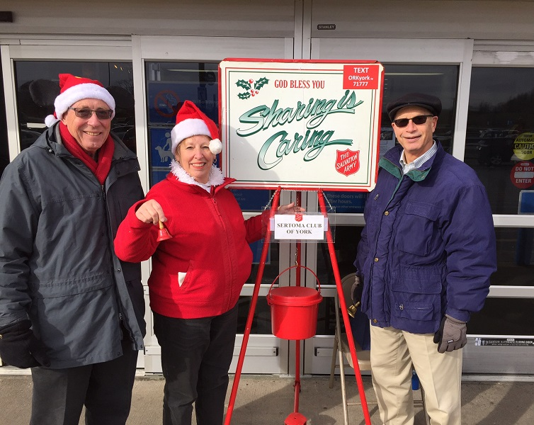 Bob & Mary Scarborough and Chris Wagman (L-R) were among a dozen Sertoma members ringing bells from 10am - 4pm on Dec. 8th in support of the Salvation Army's 2016 Red Kettle Campaign.