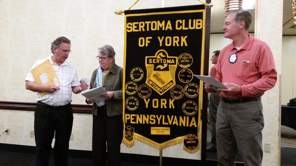 New Member Induction.  Club President Ken Smith (L) hands membership certificates to Mary Slegel and Jim Gross.
