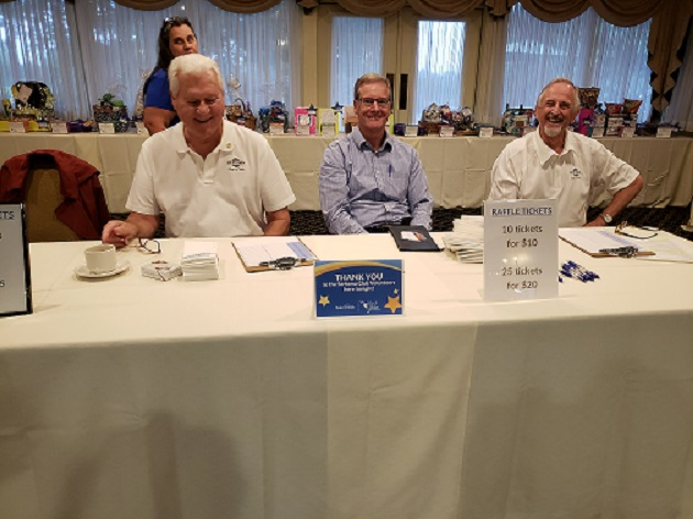 From left to right: Members Dick Lloyd, Jim Gross and Michael Patashna recently volunteered during the Make-A-Wish Foundation's annual Wine and Wishes event.