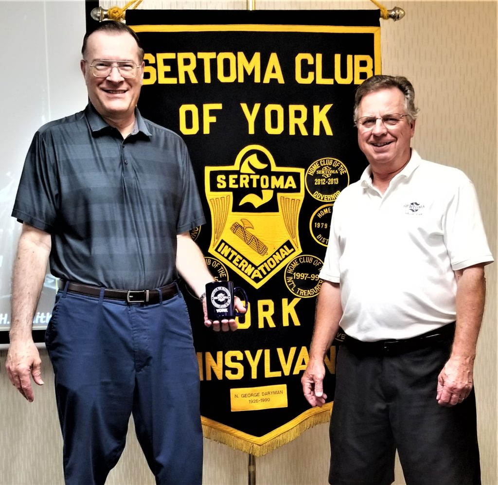 York Historian Stephen Smith (L) receives a York Sertoma mug from President Ken Smith (R).  On June 20, 2019, Stephen addressed the club about York area history.