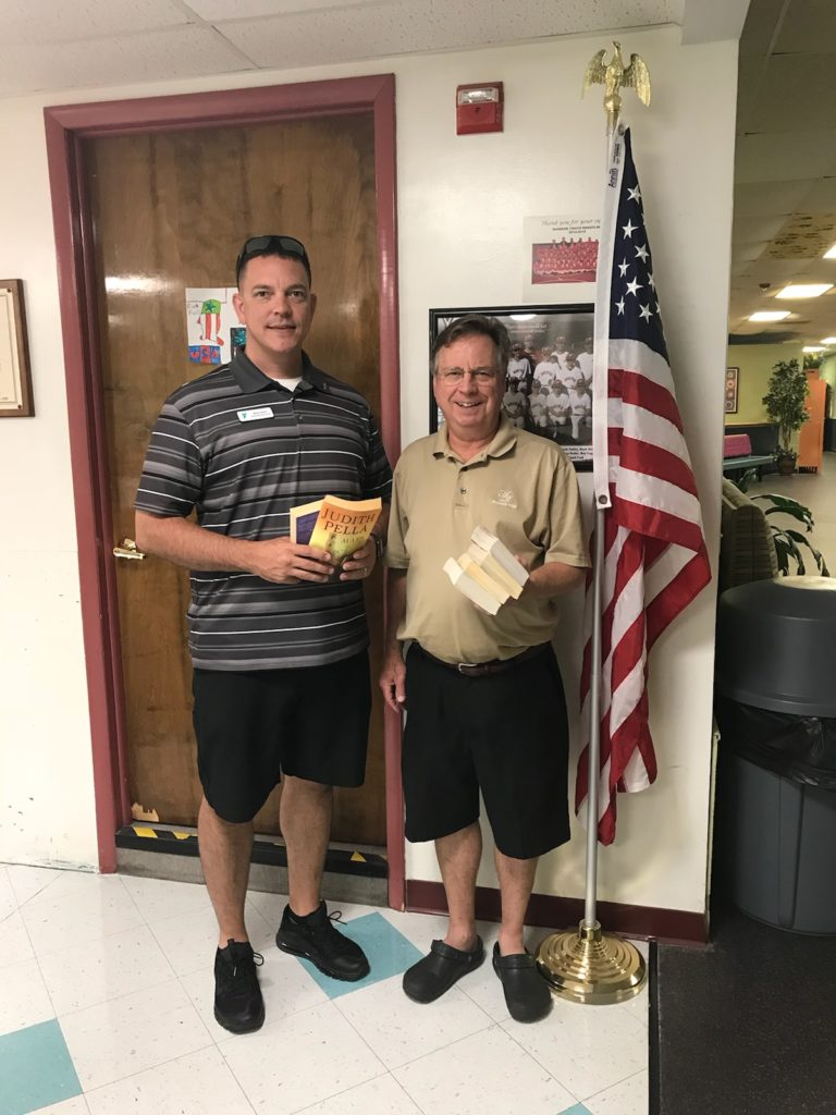 Club President Ken Smith (R) accepts a donation of books to support our Operation Paperback initiative from Michael Smith (L).  Mr. Smith is the Executive Director of the southern branch YMCA of York County.  The YMCA donates approximately 500 books to our initiative which provides books to active members and veterans of our Armed Services.