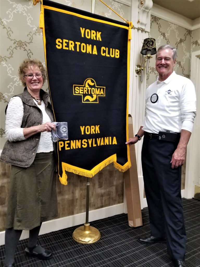 Gwen Loose, Executive Director of the York County Rail Trail Authority (L), accepts a York Sertoma mug from York Sertoma President Jim Gross (R).  Gwen addressed the club on November 7, 2019, giving the history of the Heritage Rail Trail and new initiatives by the Authority.